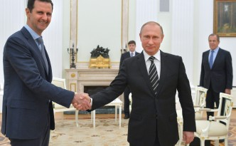 "Russian President Vladimir Putin (R) shakes hands with his Syrian counterpart Bashar al-Assad (L) during a meeting at the Kremlin in Moscow on October 20, 2015. Assad, on his first foreign visit since Syria's war broke out, told his main backer and counterpart Putin in Moscow that Russia's campaign in Syria has helped contain ""terrorism"". AFP PHOTO / RIA NOVOSTI / KREMLIN POOL / ALEXEY DRUZHININ        (Photo credit should read ALEXEY DRUZHININ/AFP/Getty Images)"